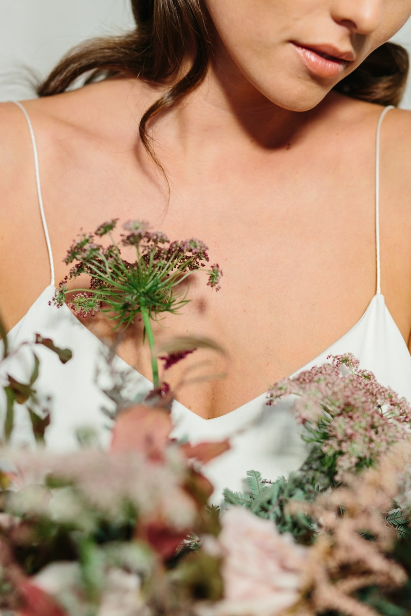 Minimalist wedding inspiration photoshoot portrait with flower bouquet